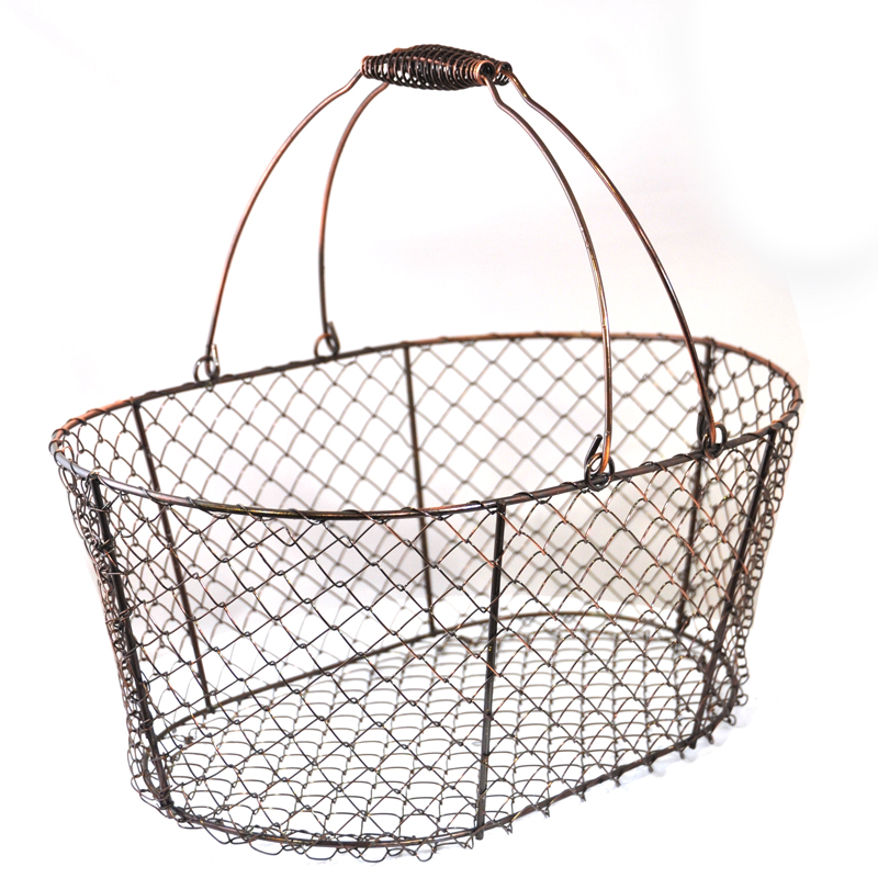 stella oblong wire basket with swing handle copper the. Black Bedroom Furniture Sets. Home Design Ideas